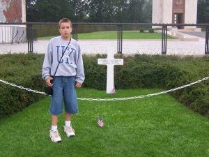 George Yost, age 11, standing in front of Patton's grave in Hamm, Luxembourg.