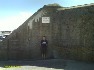 George in front of one of the German bunkers that the invading troops had to overtake.